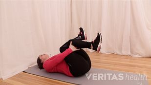 The third of three supine piriformis muscle stretch postures.