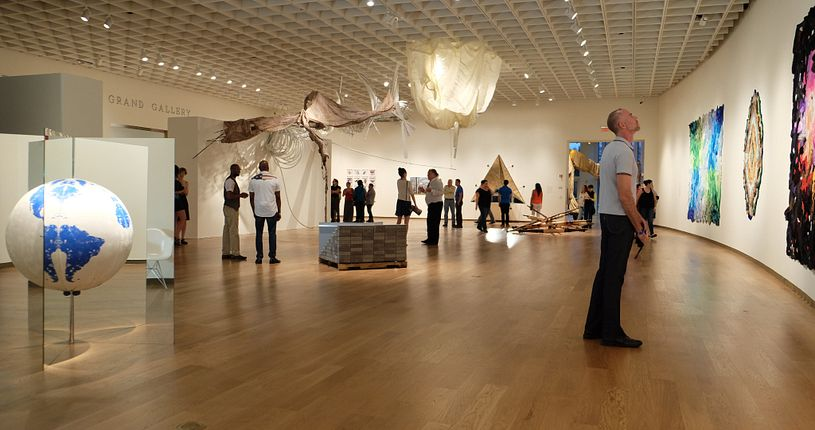 people at the Orlando Museum of Art viewing an exhibition