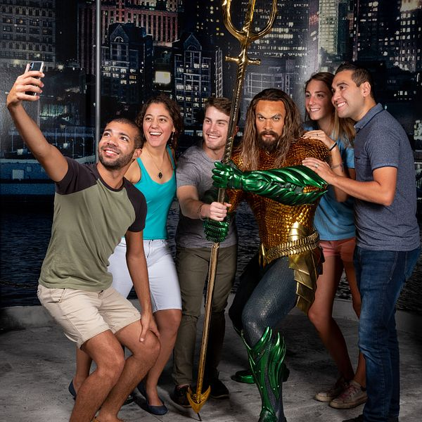 Group posing with Aquaman at Madame Tussauds Orlando