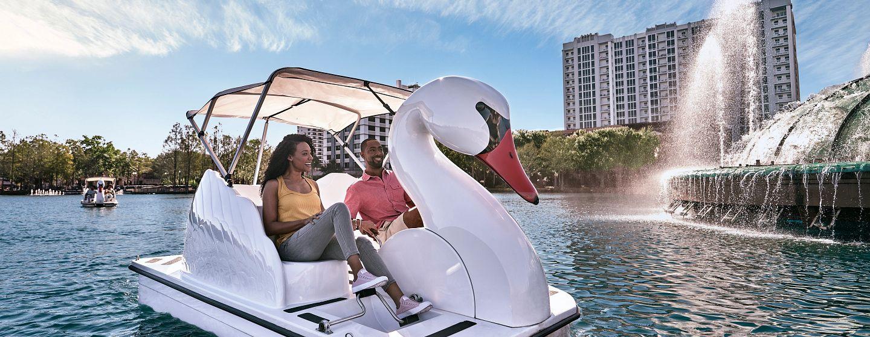 A couple enjoying the Swan Boats at Lake Eola.