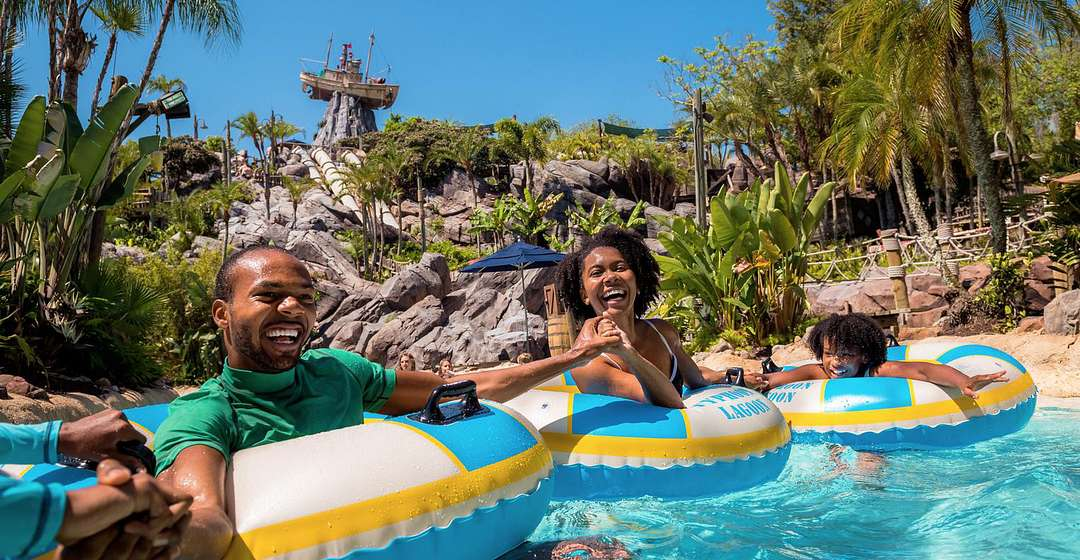 Family on water floats at Disney's Typhoon Lagoon Water Park