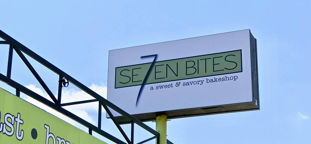 Outdoor sign of the Se7en Bites Bakeshop