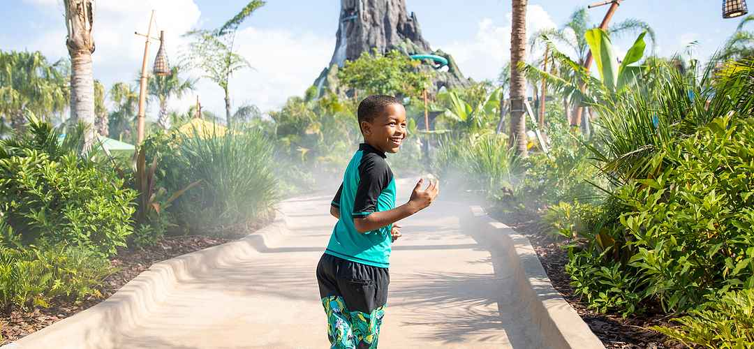 Boy walking towards the volcano at Volcano Bay at Universal Orlando Resort