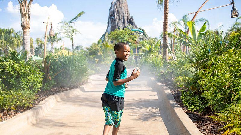 A kid on the Hon Ika Moana walkway walking towards the volcano