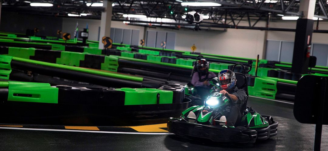 Person driving kart on track at Andretti Indoor Karting & Games