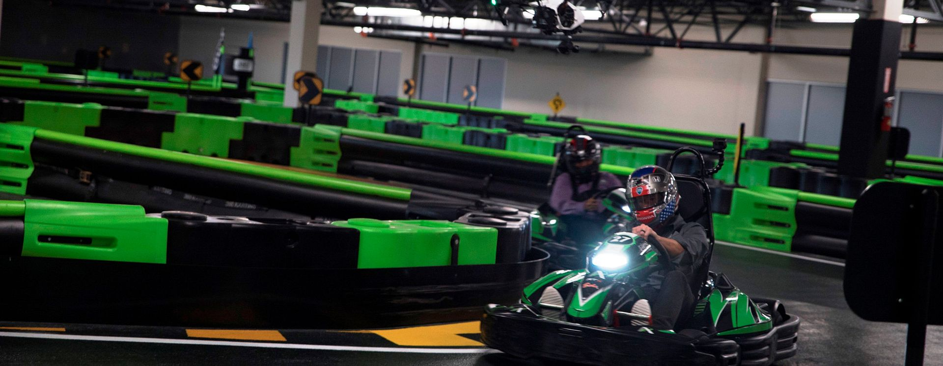 Drivers racing around an indoor track at Andretti Indoor Karting & Games in Orlando, Florida.
