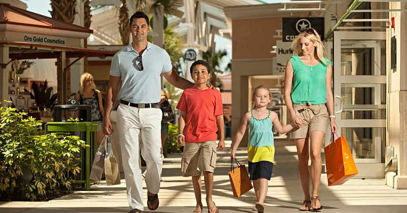 Family of four shopping at the Orlando International Premium Outlets.
