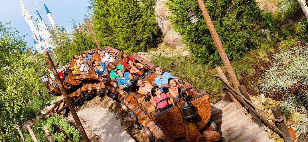 Guests riding Seven Dwarfs Mine Train at Walt Disney World's Magic Kingdom