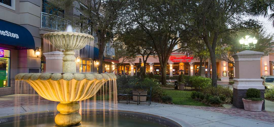 Winter Park Village water fountain with shops in the background
