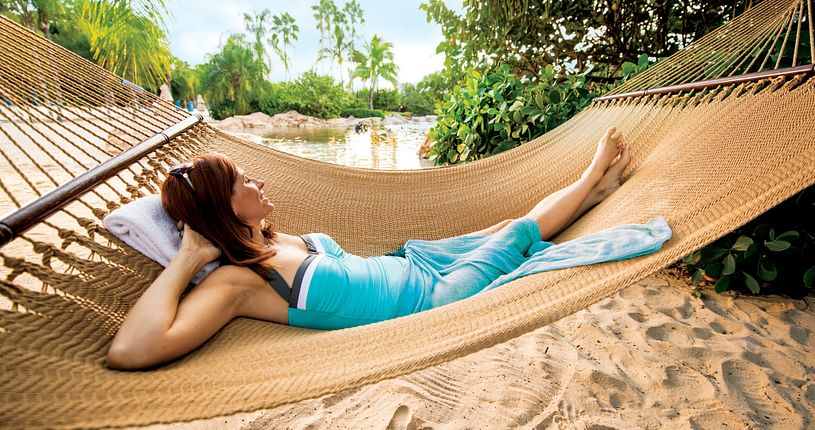 Woman relaxing in a hammock at Discovery Cove