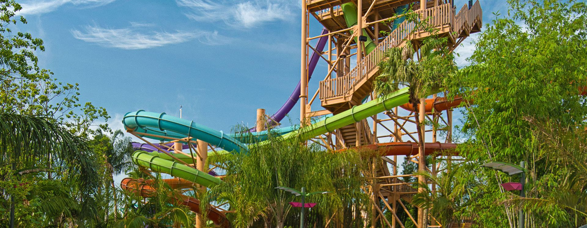 People riding Aquatica IHU Breakaway waterslides