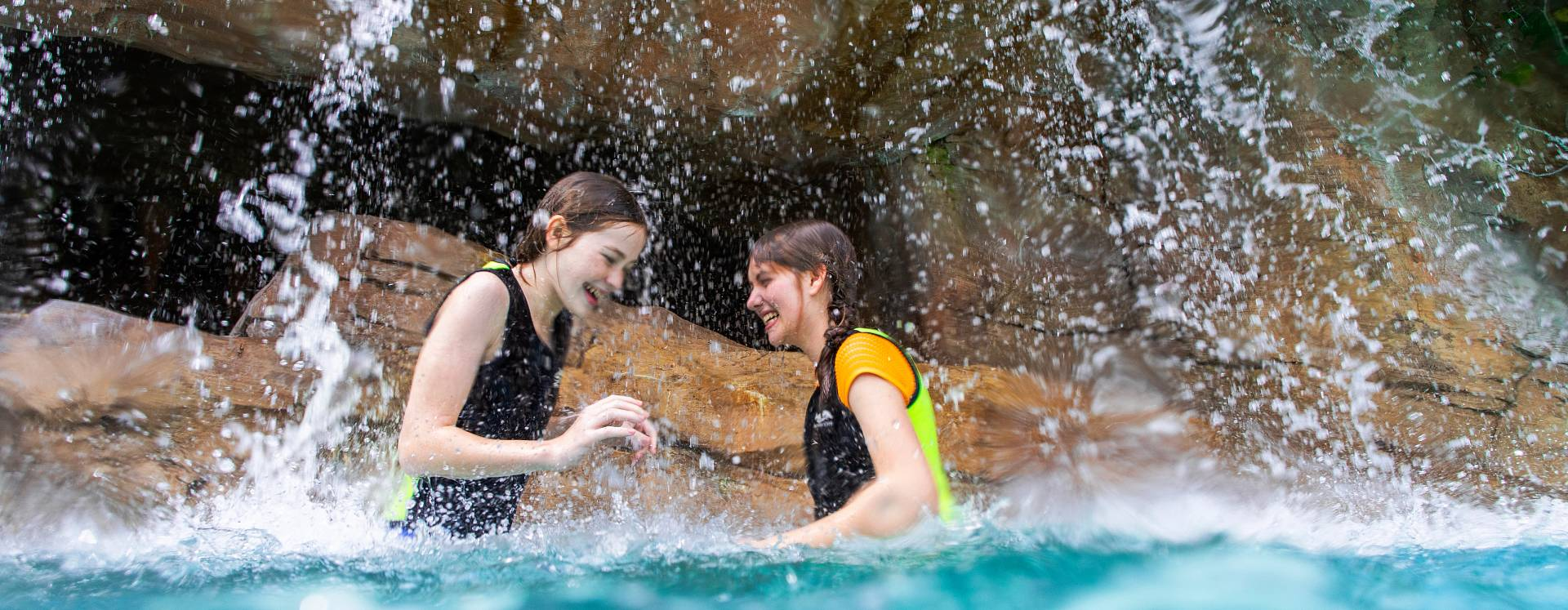 Teenagers splashing in the lazy river at Discovery Cove in Orlando