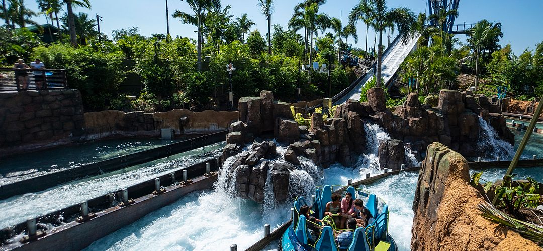 Guests getting soaked onboard a raft on SeaWorld's Infinity Falls