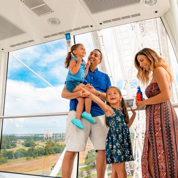 Family enjoying the view of Orlando from above on The Wheel at ICON Park