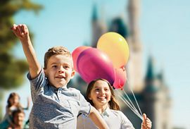 Kids with balloons at Walt Disney World's Magic Kingdom Park