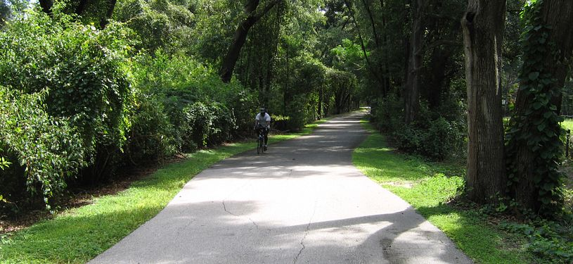 Man cycling at West Orange Trail