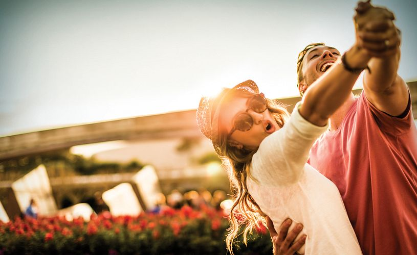A couple dancing with the sunlight shining behind them in Orlando