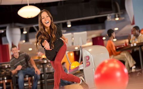 Woman bowling a strike at Splitsville in Disney Springs
