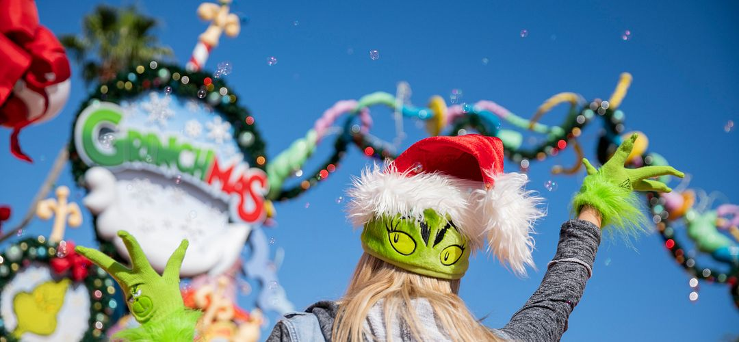 A girl in a Grinch hat celebrates Grinchmas at Seuss Landing at Islands of Adventure.
