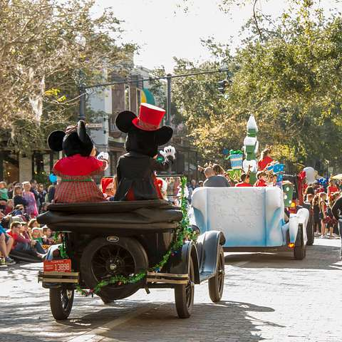 Mickey and Minnie Mouse at a Christmas parade in Winter Park