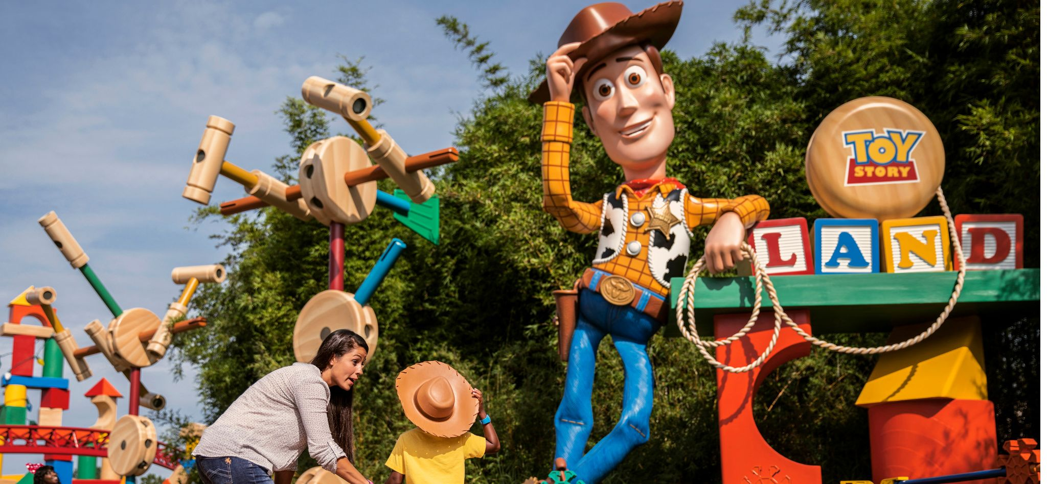 Mom and child in front of Toy Story Woody at Disney's Hollywood Studios®