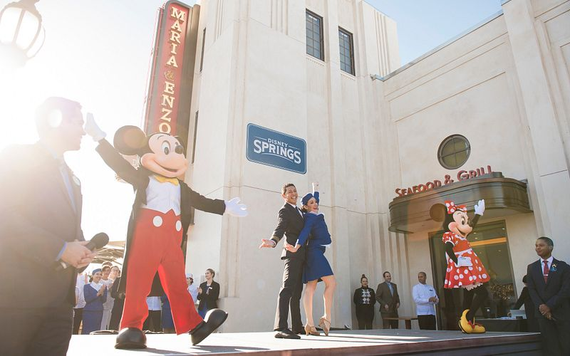 Mickey and Minnie Mouse on stage for the grand opening of Maria and Enzo's Ristorante