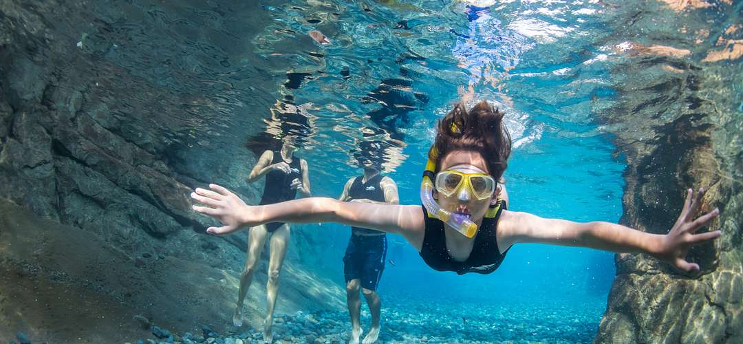 A woman snorkeling at Discovery Cove's Wind-Away River in Orlando.