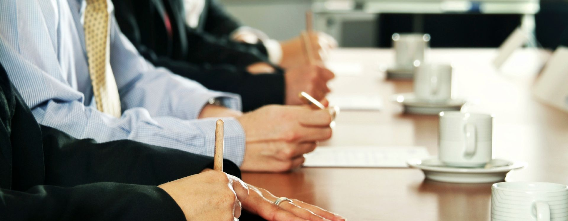 people taking notes in a meeting