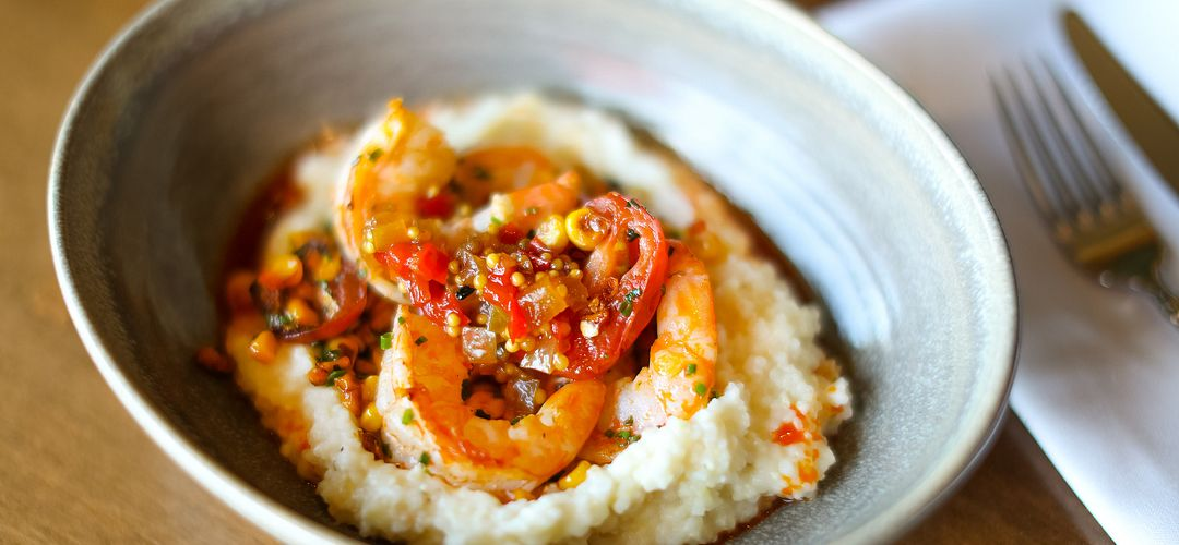 Chefs James & Julie Petrakis' Shrimp & Grits at The Ravenous Pig