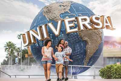 A family walking past the Universal globe in front of Universal Studios Florida