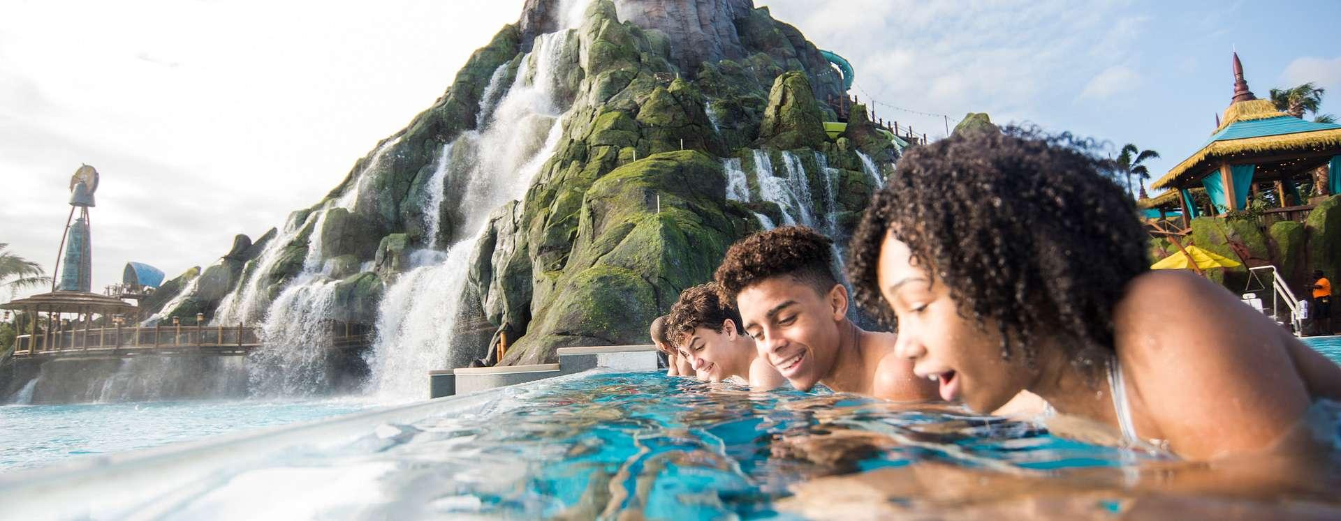 Universal's Volcano Bay™ teens gazing into Reef Leisure Pool