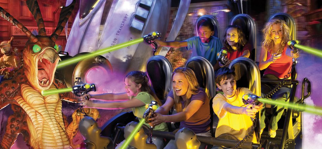 Ride the movies and blast aliens before they overrun HQ at the Men in Black: Alien Attack!