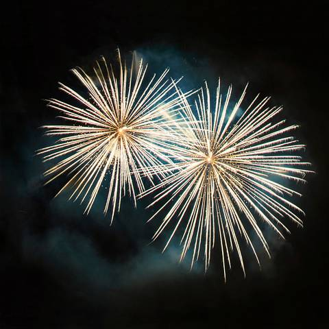 Two fireworks in the night sky