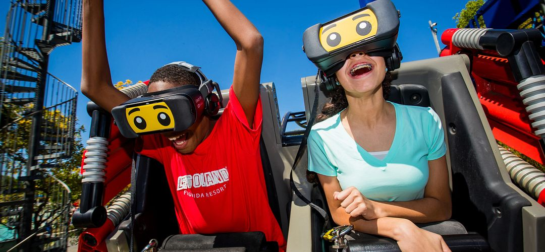 Kids riding The Great LEGO Race VR Coaster