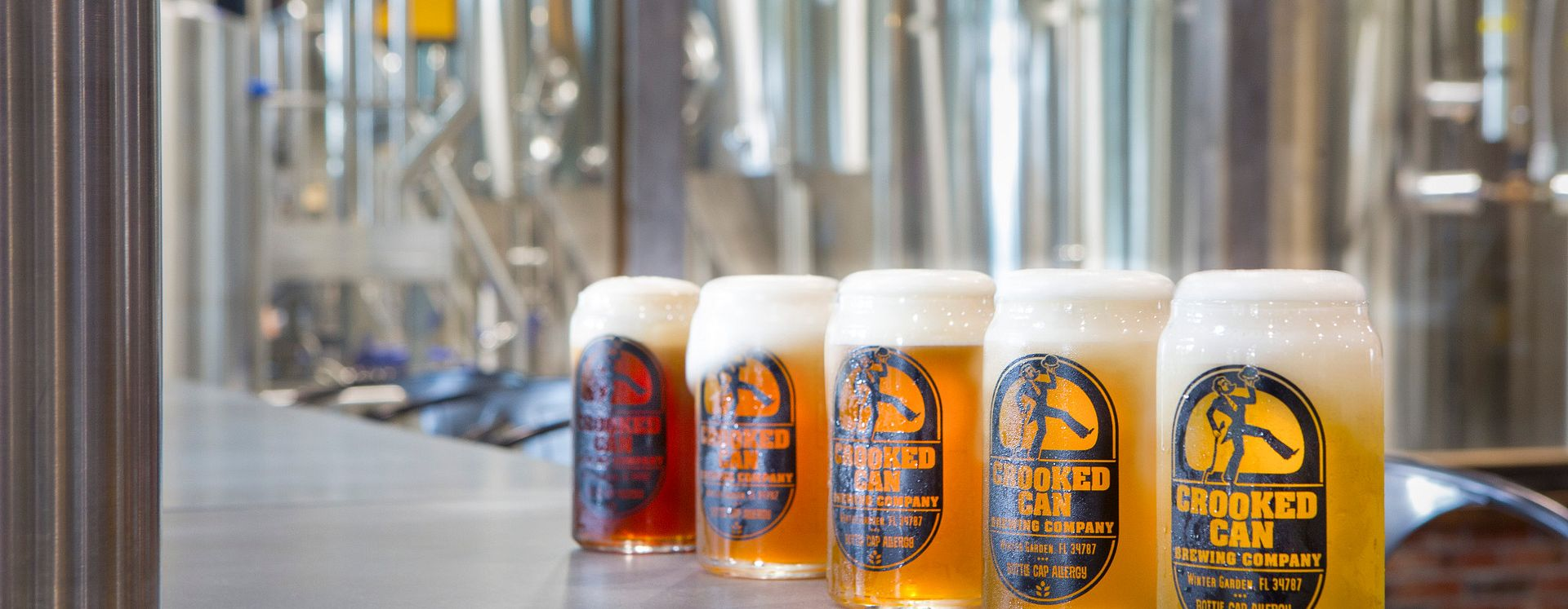 Five beers on the bar of Crooked Can Brewery