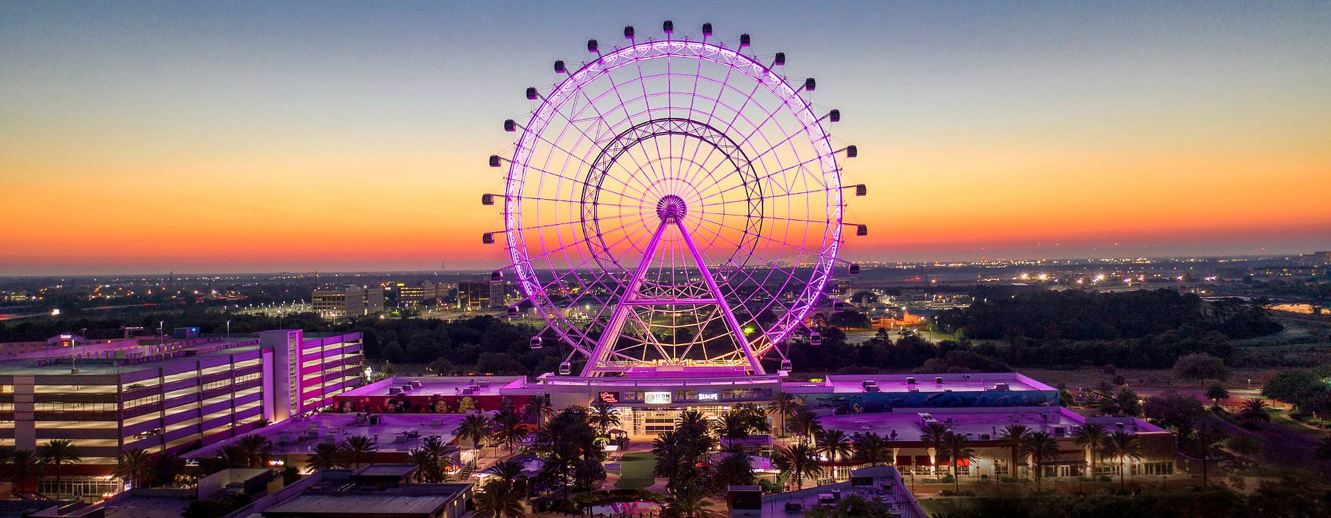 Skyline sunset view of The Wheel at ICON Park