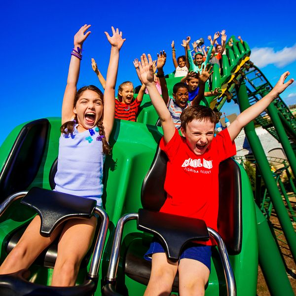 Kids on the Dragon Ride coaster at LEGOLAND Florida Resort