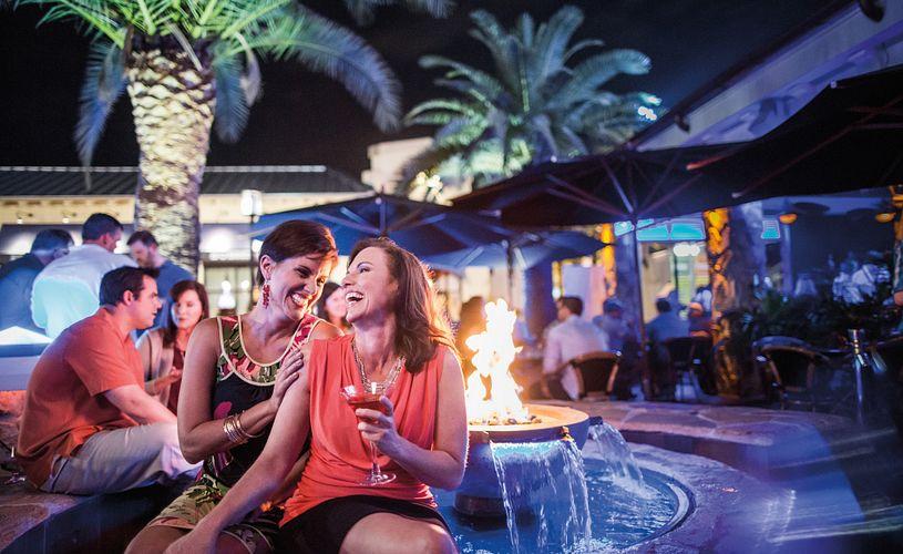 Couple enjoying cocktails outside at Blue Martini