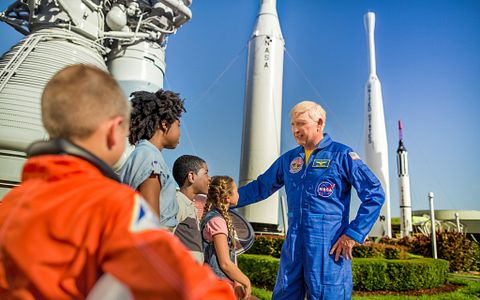 Astronaut talking to a group of children in the Rocket Garden at the Kennedy Space Center Visitor Complex