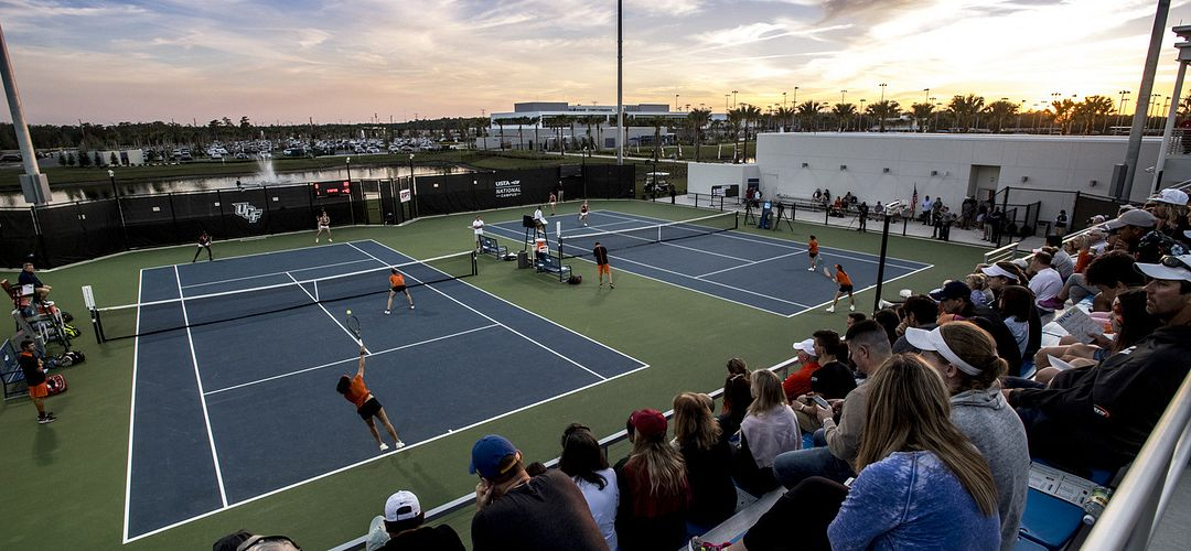 People playing tennis at the USTA National Campus Collegiate Center.