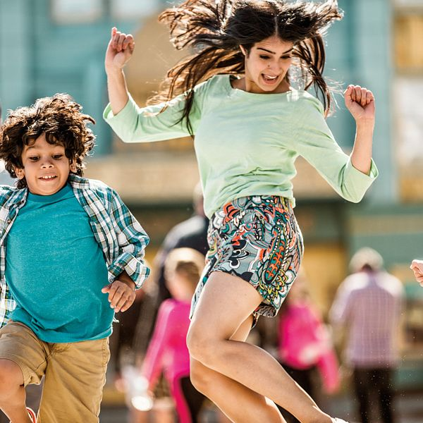 A family skipping in the street at Universal Studios Florida