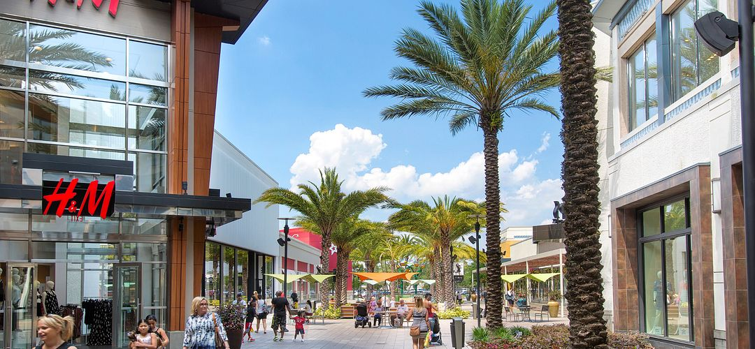 People walking on The Florida Mall promenade