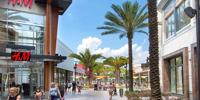 People walking on The Florida Mall promenade