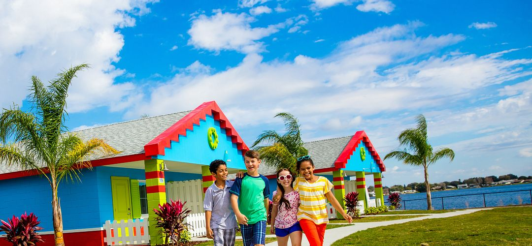 A group of kids walking near the bungalows at LEGOLAND® Florida Resort