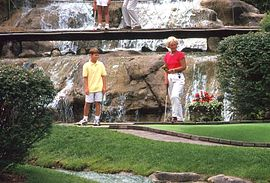 Putt your way through mountain caves, over footbridges and under waterfalls at Pirate's Cove Mini Golf