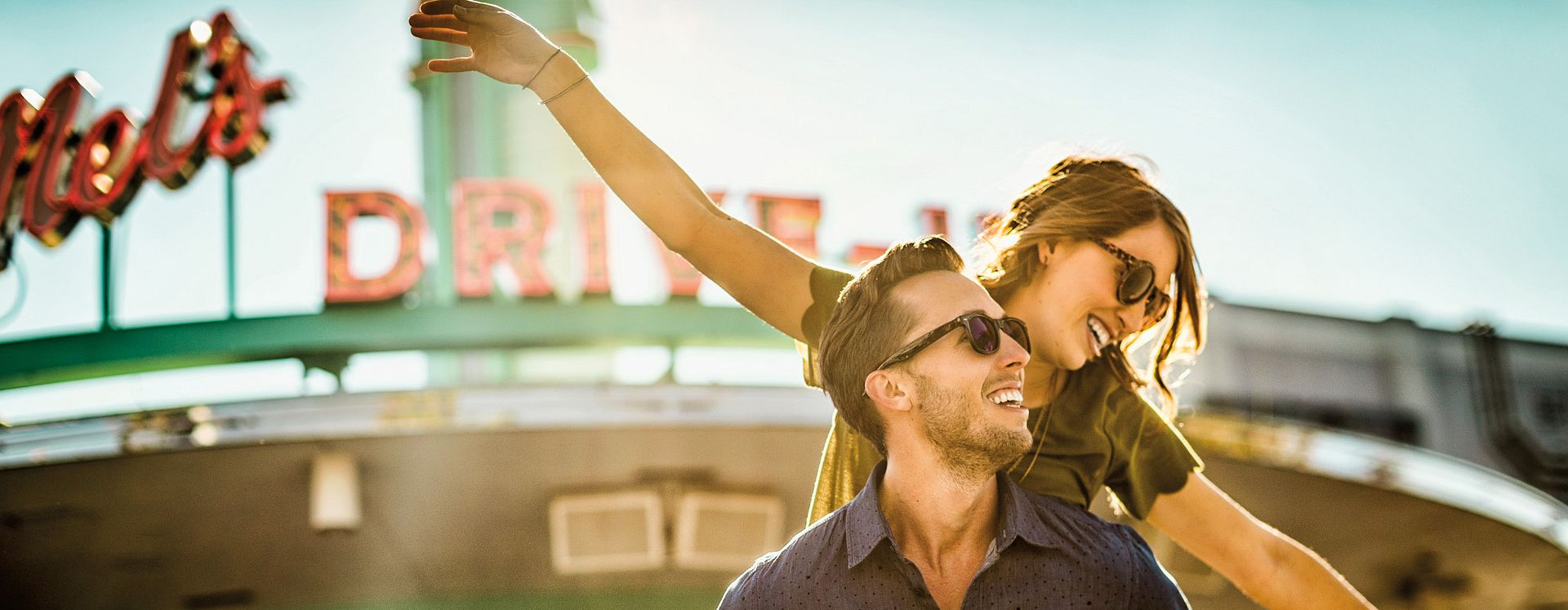 A couple having fun in front of Mel's Drive In at Universal Studios Florida