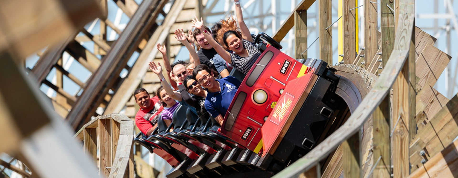 A wooden roller coaster with people laughing at Fun Spot Orlando