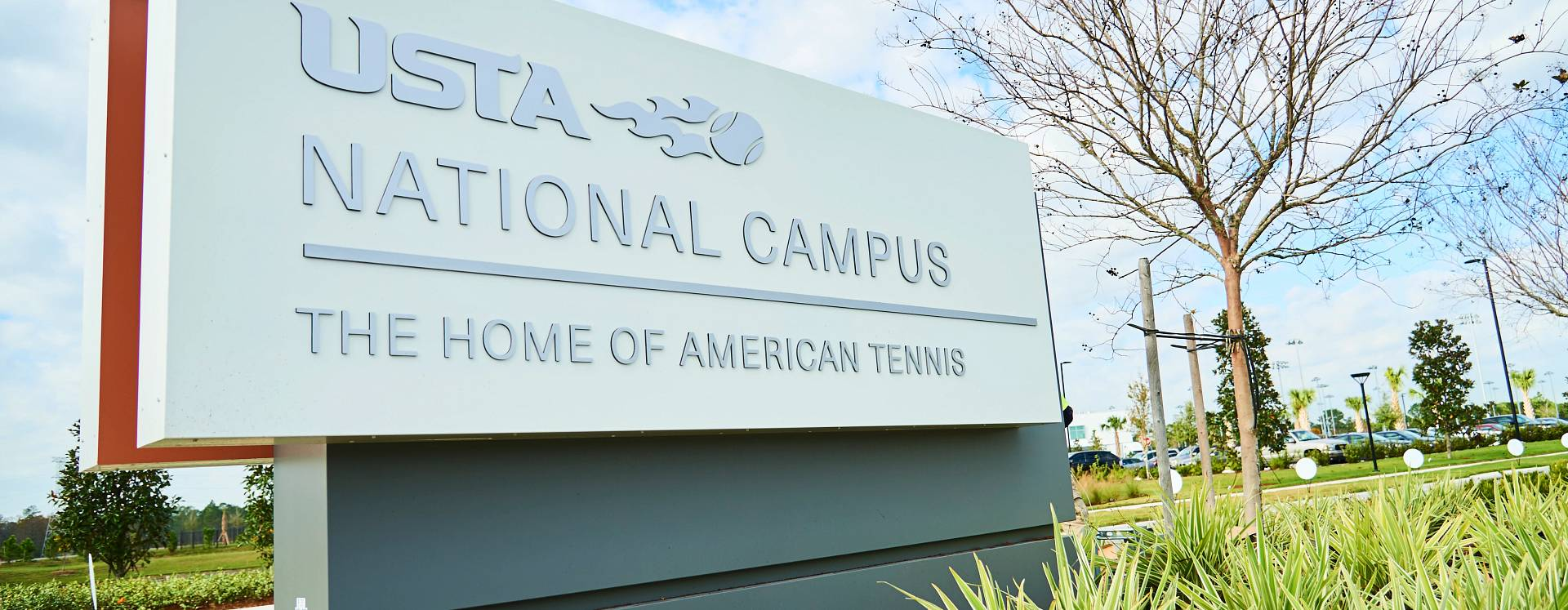 A stone entrance sign for the USTA National Campus at Lake Nona