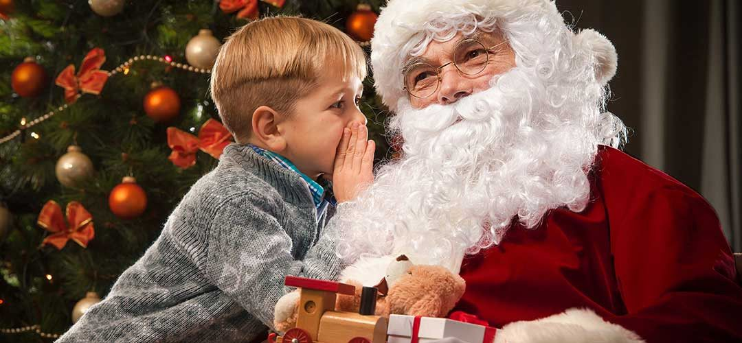 A boy meets Santa Claus at SeaWorld Orlando.
