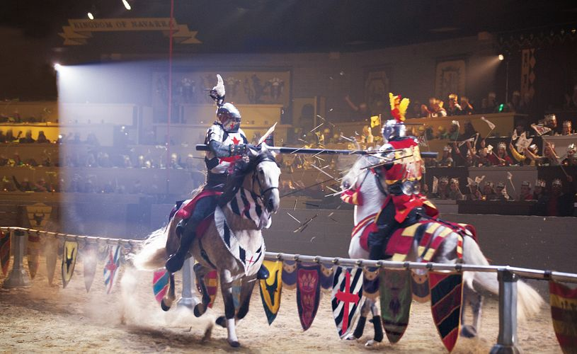 Lances shatter as two knights meet at a jousting tournament